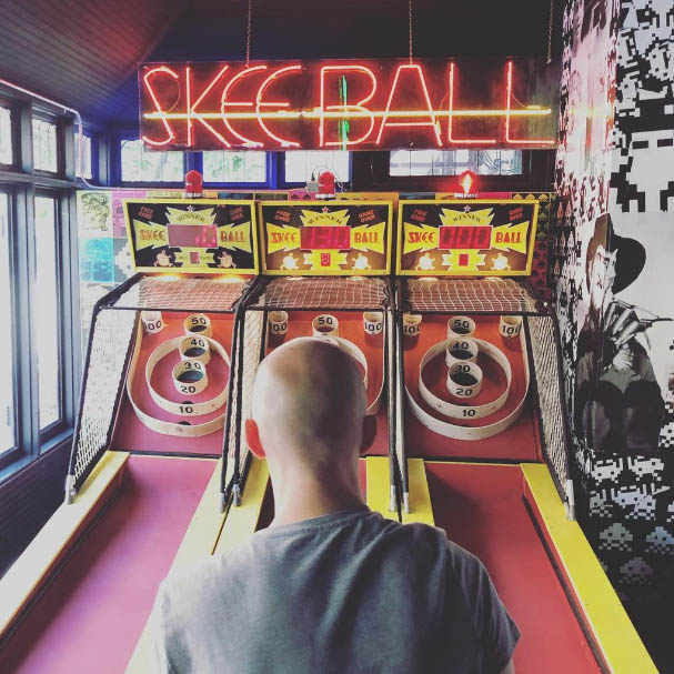Hunter Lansche playing skeeball at Up Down Arcade Bar in the Central West End