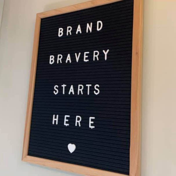photo of the words Brand Bravery Starts Here on a poster board