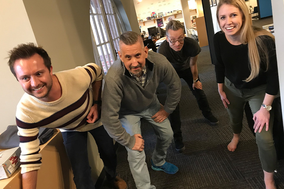 Vinnie Schieder, Steve George, Dan Graney and Jordan Ackerman preparing for a race around the office at Thanksgiving celebration