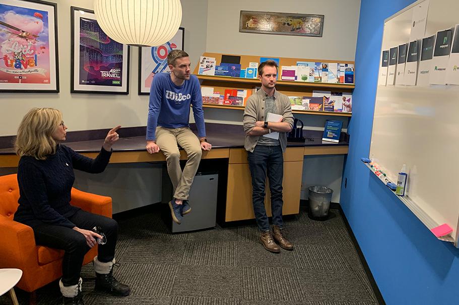 Donna MacDonald, Matt Steward and Vinnie Schnieder reviewing logo designs
