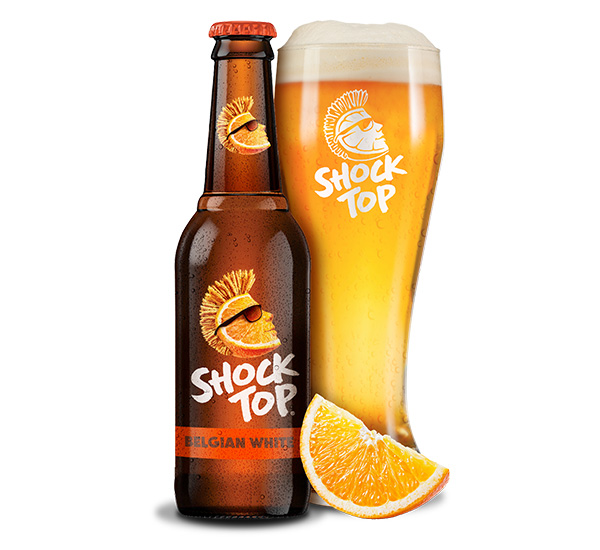 Shock Top beer bottle with tall glass and an orange wedge