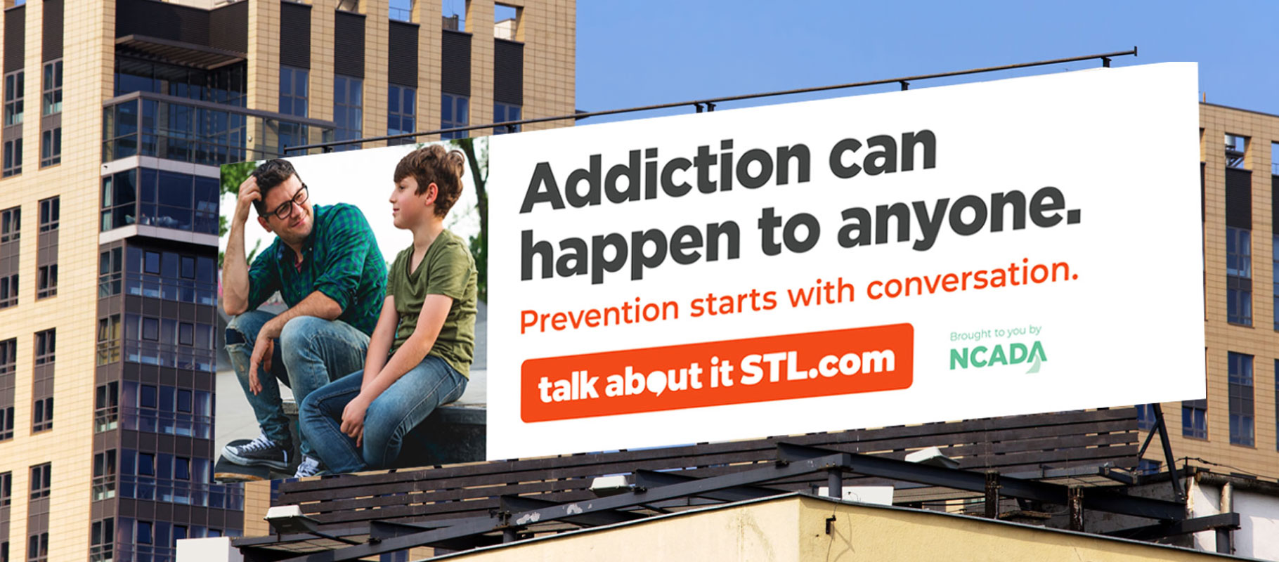Talk About It billboard sitting on top of a building